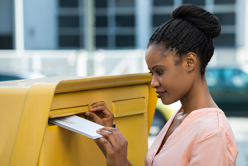 Young woman sending letter. ProTraining.